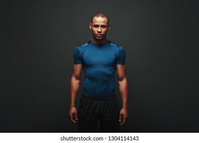 The only bad workout is the one that didn't happen. Handsome sportsman standing over dark background