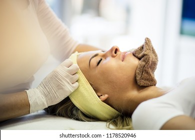 Only the best skincare regime will do. Young woman in spa center on face treatment. Close up. Copy space.