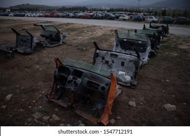 Only the front part from half cut cars. Awaiting dismantling or recycle. More vehicles in background. Kozani, Greece.