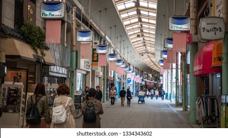 ONOMICHI, JAPAN - MARCH 25, 2017 : Japanese locals walking along the Onomichi Shopping Arcade, which is a shopping district that runs over 1km on the east side of Onomichi station.