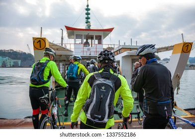ONOMICHI, JAPAN - MARCH 26, 2017 : Cyclists queuing up to ride on the ferry before starting the Shimanami Kaido which is the famous highway in Japan which connects Imabari city to Onomichi.