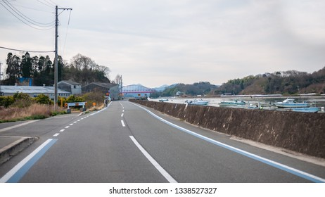 ONOMICHI, JAPAN - MARCH 26, 2017 : Empty road beside a river at Mukoujima Island which is the starting point of the Shimanami Kaido and is the northernmost island in Geiyo Islands chain.