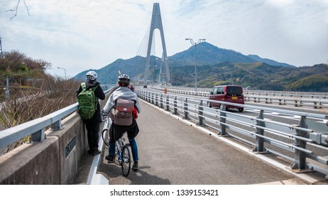 ONOMICHI, JAPAN - MARCH 26, 2017 : Ikuchi Bridge, which connects Innoshima Island with Ikuchi Island, is the second bridge to cross while on the Shimanami Kaido cycling tour starting from Onomichi.