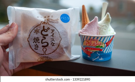 ONOMICHI, JAPAN - MARCH 26, 2017 : Double scoop of gelato in a cup and a dorayaki from Dolce, which is a shop that prides itself on its gelato made using local citrus fruits, located in Ikuchi Island.