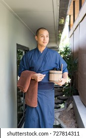 Onsen series: Asian man holding wooden bucket in ryokan