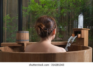 Onsen series : Unrecognizable woman in wooden bathtub