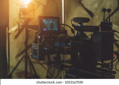 on-set movie camera. blurry background