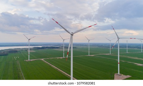 onshore wind turbines lined up in series