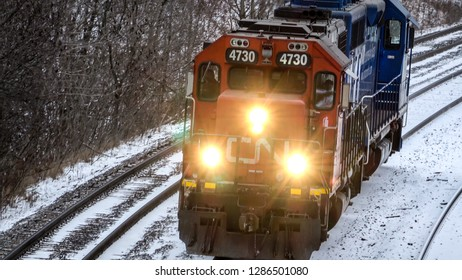 ONTARIO CANADA - JAN 12 2019:  A short CN (Canadian National Railway) train traveling in a rural area in winter