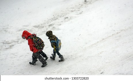 ONTARIO CANADA - JAN 28 2019: School kids walking home with heavy snow on the ground as major winter storm hit cities in Ontario