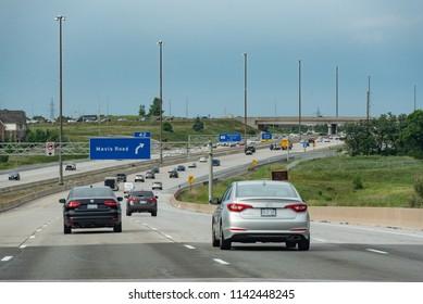 Ontario, Canada - July 5, 2018:  Highway 407 ETR at Mavis Road interchange in northwest Mississauga.