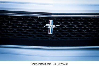 ONTARIO CANADA - JUNE 2 2018: A Mustang pony front emblem and grill at a car show in Oakville. The Ford Mustang is an American car manufactured by Ford