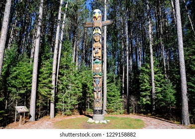 Ontario, Canada, November 4, 2018: The Let it stand Totem Pole at the East Gate, Algonquin Park.
