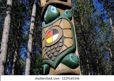 Ontario, Canada, November 4, 2018: The Let it stand Totem Pole- the Turtle carving section at the East Gate, Algonquin Park.