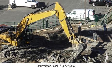 ONTARIO CANADA - OCTOBER 2016: An excavator moving metal debris in a construction site