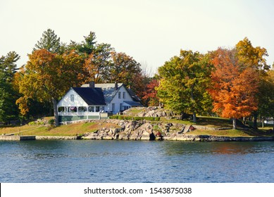 Ontario, Canada - October 24, 2019 - A private island with waterfront home along St Lawrence River and the famous Thousands Islands