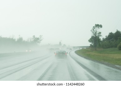 Ontario, Canada.  Traffic on Highway 400 north of Toronto during a summer evening thunderstorm.