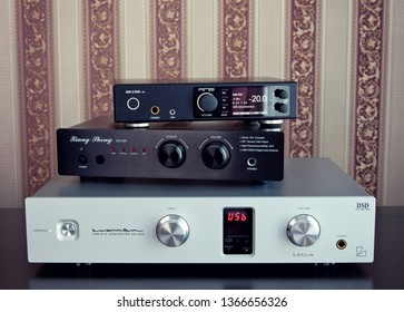 Ontario/Canada - April 11 2019: Multiple digital to analog converters (DACs) piled up and prepared for comparative listening test, closeup
