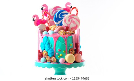 On-trend candyland fantasy drip cake for children's, teen's birthday, anniverary, mother's day and valentine's day celebrations, on white background.