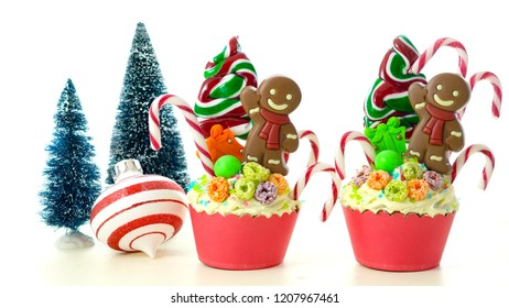 On-trend candyland festive Christmas cupcakes on white background.