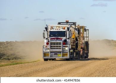 OODNADATTA, AUSTRALIA - MAY 10, 2014: Roadtrain in the outback of Australia