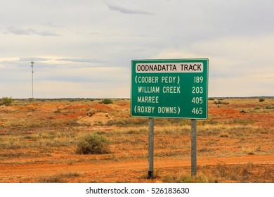 Oodnadatta Track, Marla, South Australia, Australia, december 21, 2011: Board with distances to Coober Pedy, William Creek, Marree and Roxby Downs