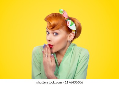 Oops. Closeup portrait of a red head young woman pretty pinup girl green button shirt covering her mouth in I made an error, omg sign gesture isolated yellow background retro vintage 50's style.