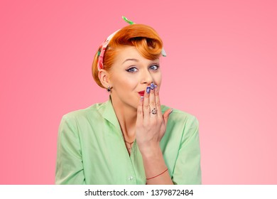 Oops, I shoud not tell that. Closeup portrait redhead young woman pinup girl in green button shirt covering mouth in I made an error, omg sign gesture isolated pink background retro vintage 50s style