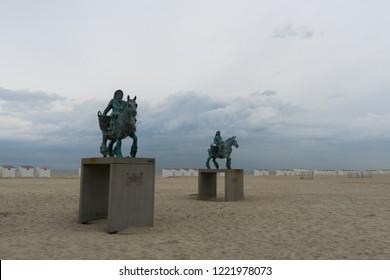 Oostduinkerke, Belgium - August 6, 2018: Statue Cloned Paardenvisser, bronze sculptures by William Sweetlove of shrimper on horseback on the beach at Oostduinkerke, Belgium - Beaufort 2018