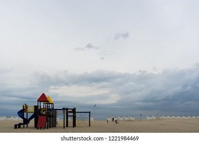 Oostduinkerke, Belgium - August 9, 2018: Playing at the beach of Oostduinkerke West Flanders Belgium in the early morning