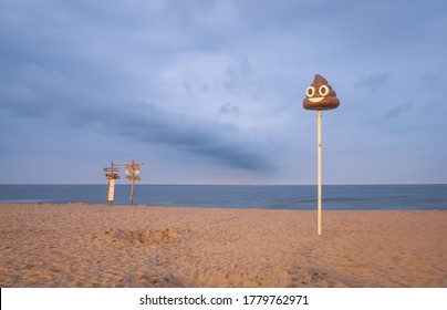 Oostende, Belgium - 10 July 2020: Orientation pole in the shape of poo on the beach