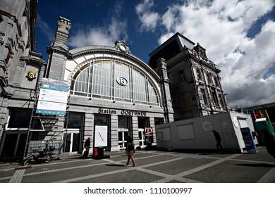 Oostende Belgium Apr. 17, 2016. Travelers walk outside of the Oostende train station.