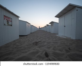 Oostende, Belgium - August 7, 2018: Beach cabins some of which are tagged on the beach of Ostend, early in the morning.