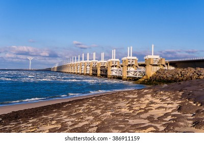 Oosterscheldekering is a flood barrier in the Oosterschelde river protecting the inland from floods, part of the Dutch Delta Works