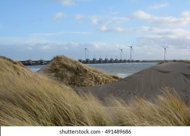The Oosterscheldekering (in English: Eastern Scheldt storm surge barrier) seen from behind the dunes. Island: Schouwen-Duiveland, Province: Zeeland, Country: Netherlands