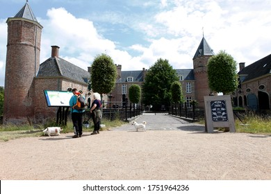 Oostkapelle, Zeeland, Nethetlands - June 2020 - Two tourist in front of the Castle Westhove you can visit in Oostkapelle (near Domburg)