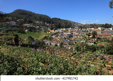 OOTY, INDIA - MAY 01: City buildings and houses as visible form the Rose garden hills on May 01,2016 in Ooty,Tamil Nadu, India. Ooty is a major hill station and tourist destination in south India