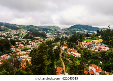Ooty, India. Nilgiri mountains in Ooty, South India. View of the picturesque valley during the cloudy day. Beautiful houses and hotels. Very green touristic area
