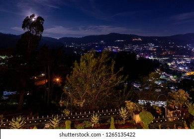 OOTY, TAMIL NADU, INDIA - OCTOBER 25, 2018: A view from terraced gardens of the Gem Park Hotel at dusk in Ooty, that overlooks the hill station town below, which is also known as Udhagamandalam.