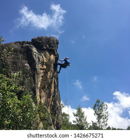 Ooty,India-December2016:A man is involved in abseiling,one of the famous outdoor activities for adventure seeker traveler at Ooty,India.