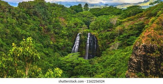 'Opaeka'a Falls cascading into the lush surrounding jungle in Wailua River State Park on the island of Kauai, Hawaii.  USA