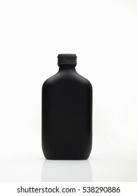 Opaque black bottle of perfume for men against white background