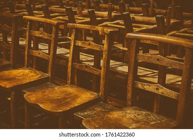 Opaque Old Wooden Chairs in Row in a Church