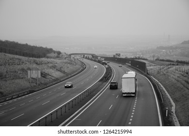 Oparno, Czech republic - December 19, 2018: cars and camion on highway D8 near Oparno village in czech central mountains