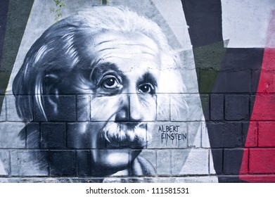 OPATIJA CROATIA - CIRCA JUNE 2012: Albert Einstein (1879-1955) graffiti in Angiolina  park, Opatija circa June 2012.Faces on this wall represent famous people who visited this Croatian touristic city.