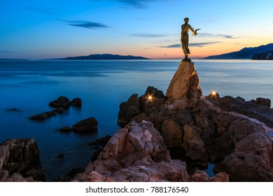 OPATIJA, CROATIA - DECEMBER 30, 2017: Maiden with the Seagull Statue, the famous landmark of Opatija in the evening.
