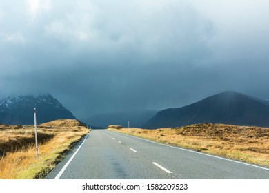 Open 2 lane road in rural countryside. Weather change in Scottish Highlands. Glencoe, Scotland, UK.