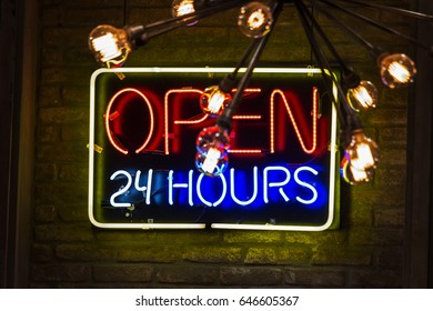 Open 24 hours neon old vintage sign at Sao Paulo - 2017