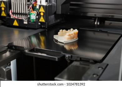 Open 3D Printer With Finished 3D Printed Dental Implant Bridge.