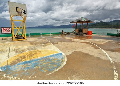 Open air basketball court built on the concrete upper surface of the dock-ferry boat terminal for the tourist bangkas going to Puerto Princesa Subterranean River Nnal.Park. Sabang-Palawan-Philippines.